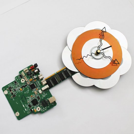 Tech Flower Wall Clock in Circuitboard Pot - Click Image to Close